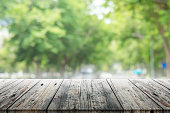 Empty wooden table with blurred party on background