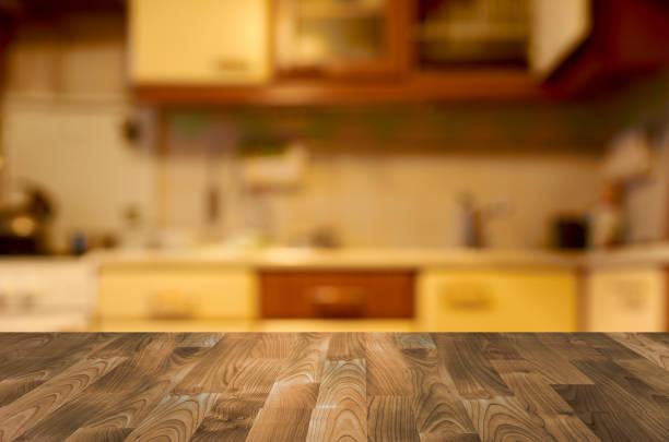 empty wooden table with kitchen bokeh - kitchen counter imagens e fotografias de stock