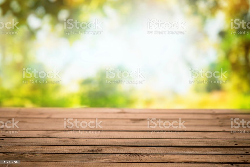 Empty wooden table with nature background - Fall stock photo