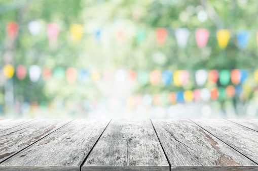 istock Empty wooden table with party in garden background blurred. 599716858