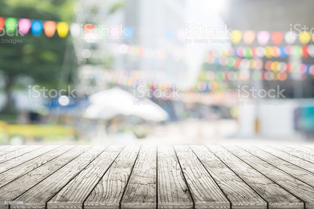 Empty wooden table with party in garden background blurred. stock photo