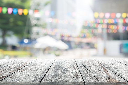 istock Empty wooden table with party in garden background blurred. 619771376