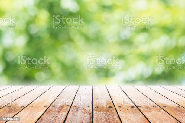 Empty Wooden Table With Party In Garden Background Blurred Stock Photo - Download Image Now