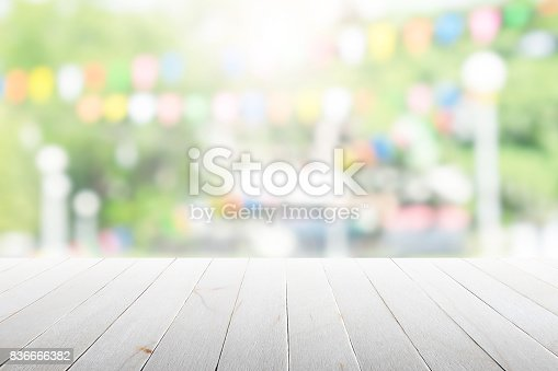 istock Empty wooden table with party in garden background blurred. 836666382