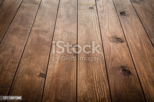 High angle view of a rustic wooden table with vertical stripes. Ideal for product display on top of the table. Predominant color is brown. DSRL studio photo taken with Canon EOS 5D Mk II and Canon EF 24-105mm f/4L IS USM Wide Angle Zoom Lens