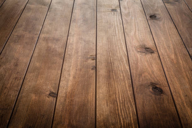 empty wooden table with vertical stripes - diminishing perspective stock photos and pictures