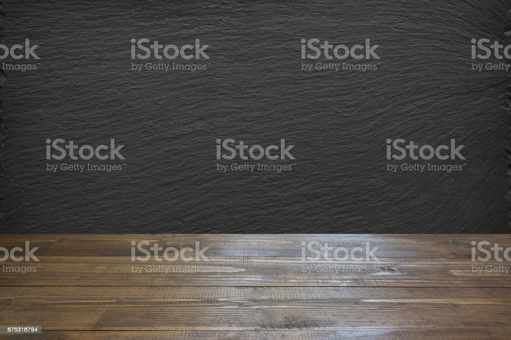 Empty wooden tabletop and black slate chalckboard for display or montage your products. stock photo