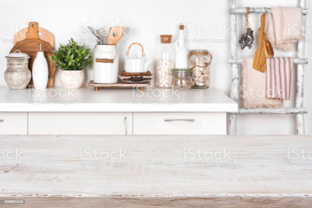 Empty wooden texture table with blurred image of kitchen interior stock photo