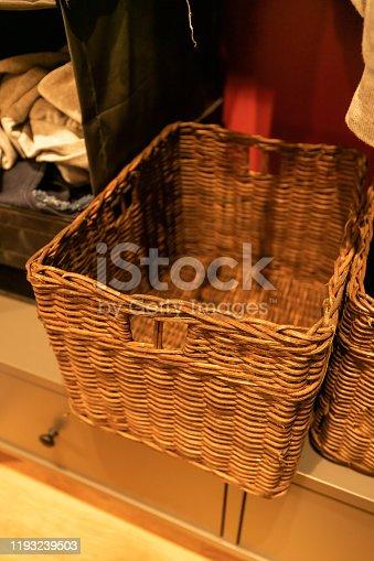 Empty wooden wicker basket, clothes storage basket