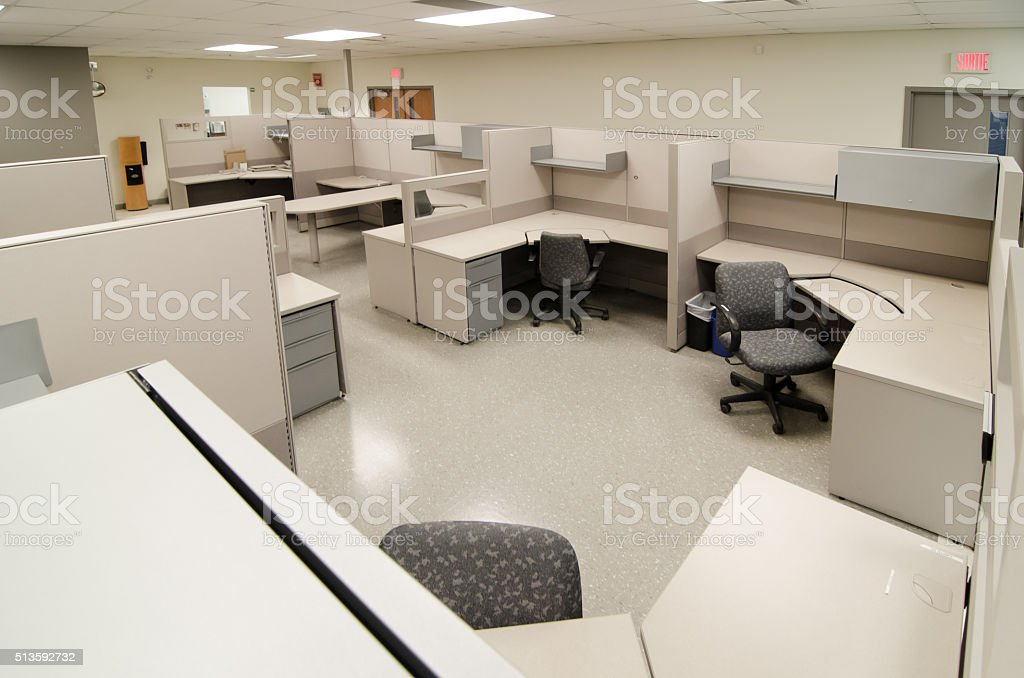 Empty work office cubicles color beige with chairs and tables