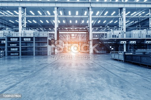 istock Empty workshop with a lift in a car repair station 1058437804