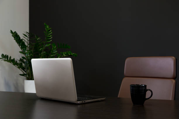 Empty workspace in home office with laptop and coffee cup stock photo