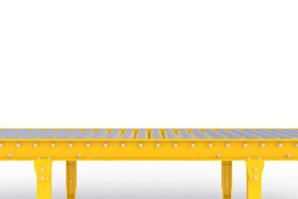 empty yellow conveyor line isolated on a white background, delivery concept, for product display, 3d rendering - linia produkcyjna zdjęcia i obrazy z banku zdjęć