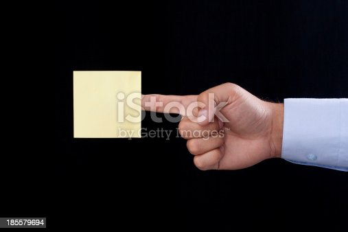 Blank Yellow Note On the Index Finger