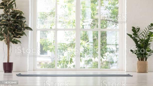 Empty yoga studio interior with windows and unrolled mat picture id1180509487?b=1&k=6&m=1180509487&s=612x612&h=pnati f3latorjtchcapexyryd821mgdgih4gjsyogo=
