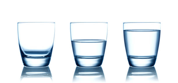Empty,half and full water glasses . Isolated on white stock photo