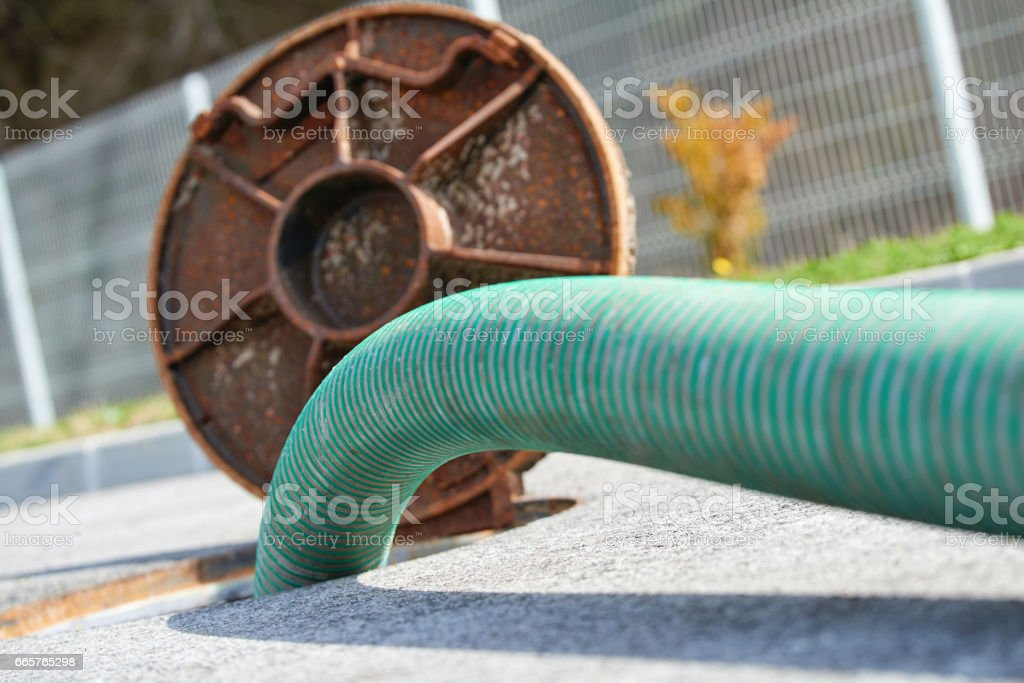 Emptying septic tank, cleaning the sewers stock photo