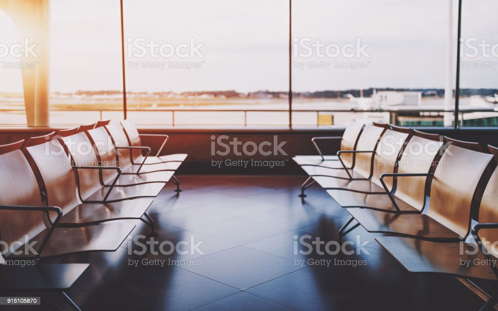 Empyy rows of seats in waiting room of airport stock photo