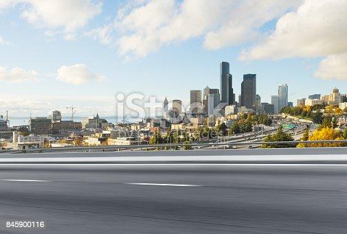 860403416istockphoto emtpy asphalt road with cityscape of modern city 845900116