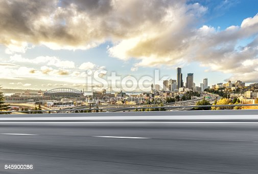 860403416istockphoto emtpy asphalt road with cityscape of modern city 845900286