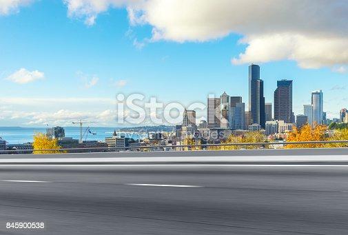 860403416istockphoto emtpy asphalt road with cityscape of modern city 845900538
