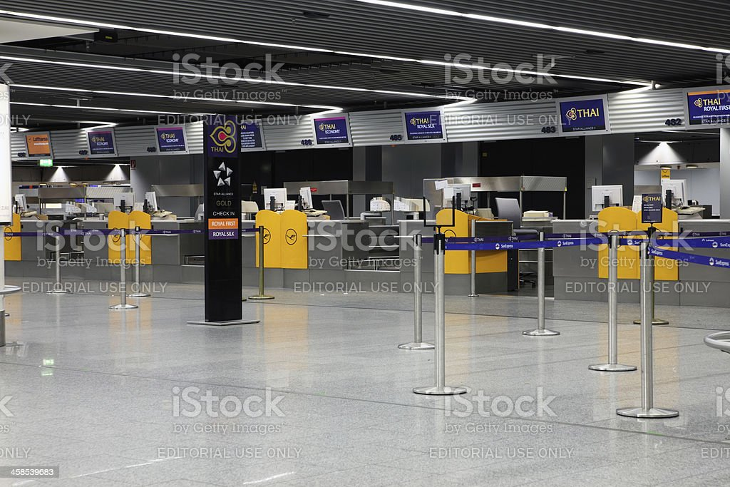 Emtpy check in counters at airport stock photo