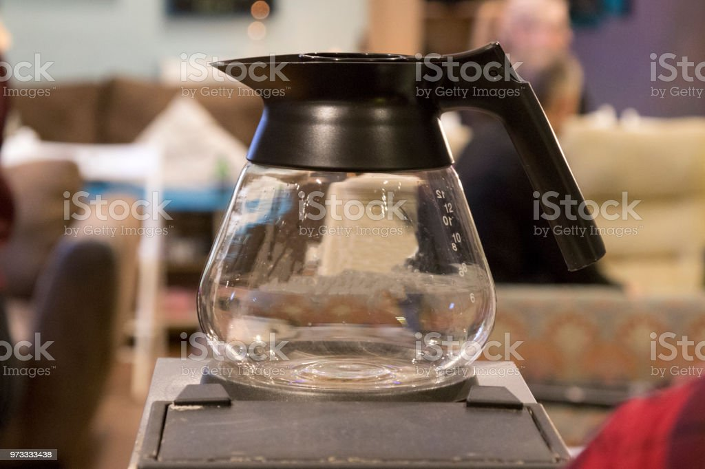 Emtpy glass coffee pot on top of a coffee machine Emtpy glass coffee pot on top of a coffee machine Breakfast Stock Photo