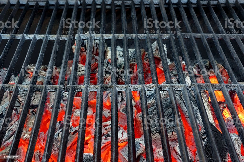 Emty Hot Barbecue Grill With Glowing Charcoal Background stock photo