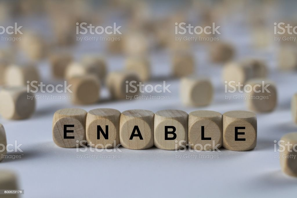 enable - cube with letters, sign with wooden cubes stock photo