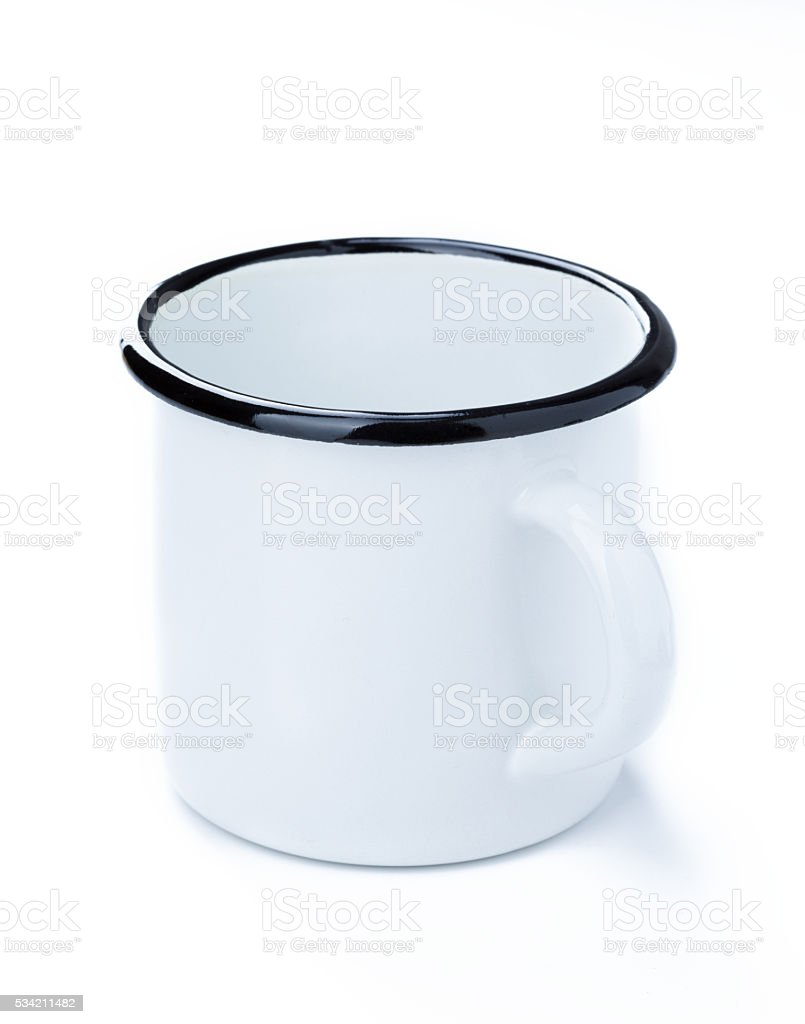 Enamel tin cup stock photo