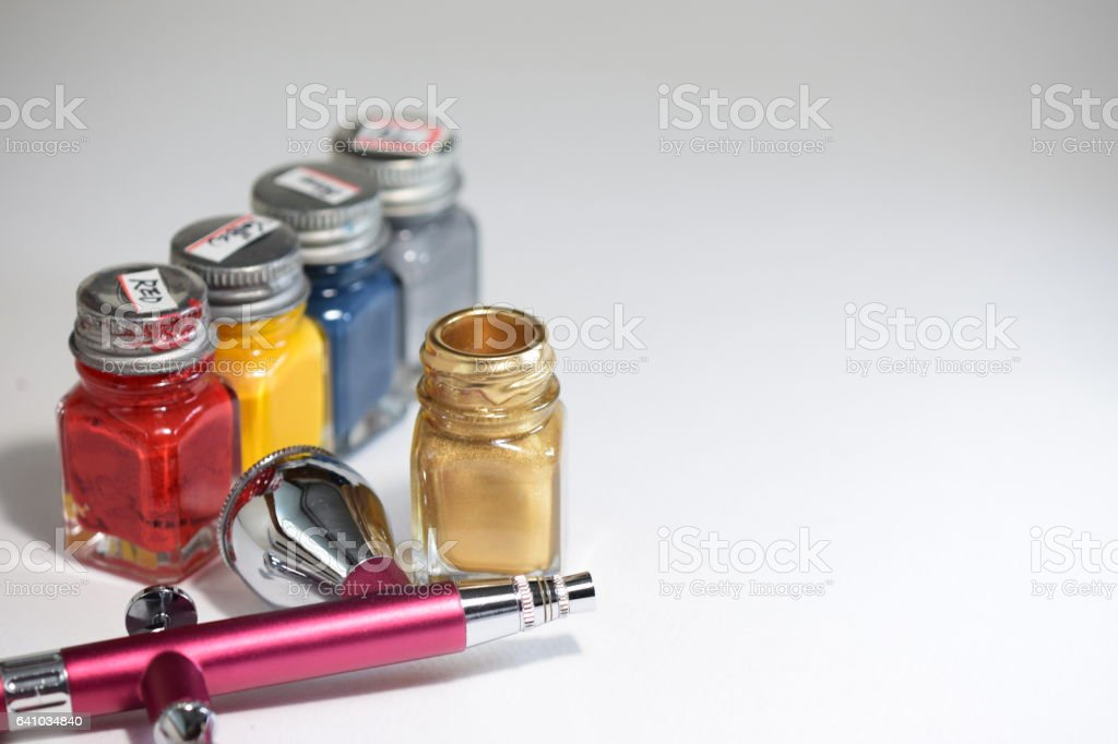Enamel paints and an airbrush stock photo