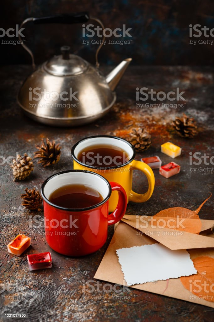 Enameled cup of hot tea stock photo