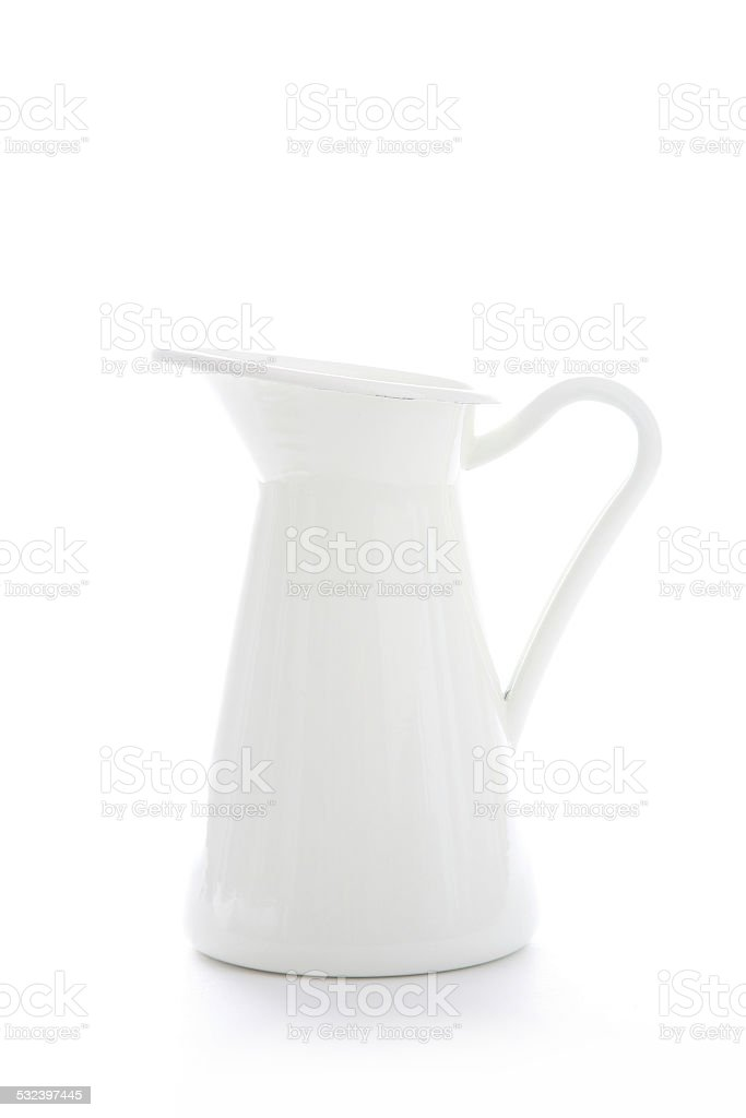 Enamelled metal jug on white background stock photo