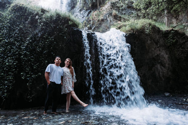 Enamored young couple standing with a beautiful nature scene behind. Ruta los bolos, Granada, Spain Enamored young couple standing with a beautiful nature scene behind. Ruta los bolos, Granada, Spain bolos stock pictures, royalty-free photos & images