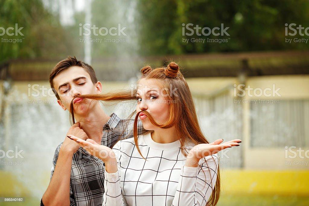 Enamoured teenagers fooling around. stock photo
