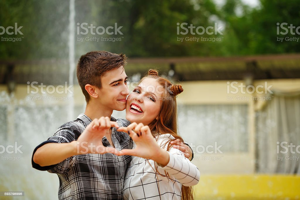 Enamoured teenagers made heart stock photo