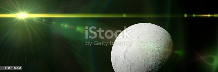 istock Enceladus, planet Saturn's moon in front of the galaxy and a bright star 1128718008