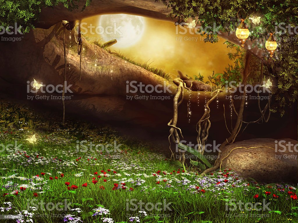 Enchanted cave with flowers stock photo
