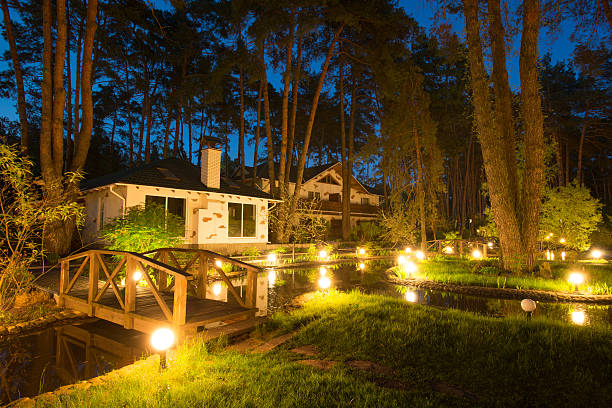 Enchanted house Cozy resort by the lake in the conifer forest at night russian dacha stock pictures, royalty-free photos & images
