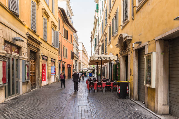 enchanting old buildings and historical streets in rome. - rome road central view foto e immagini stock