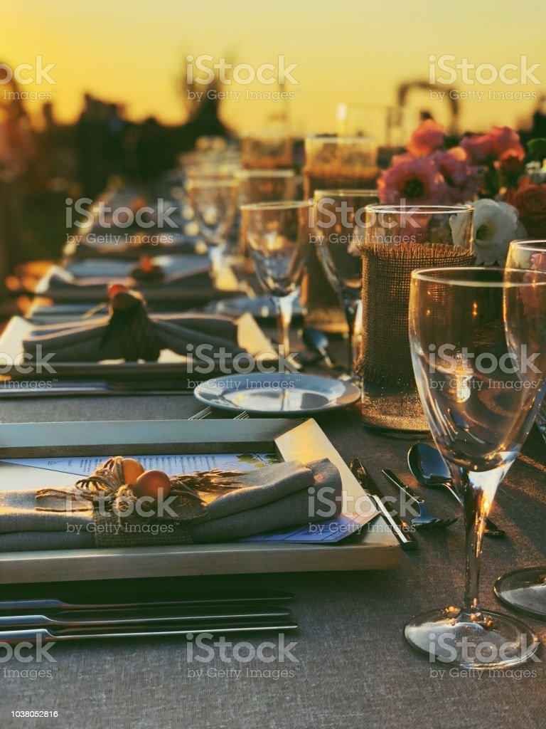Enchanting Wedding ceremony setting at sunset stock photo