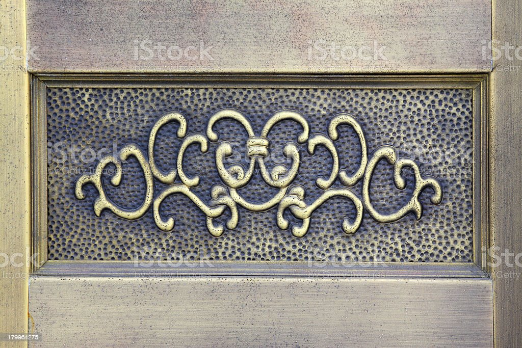 enchased in metal decorative pattern on the wall royalty-free stock photo