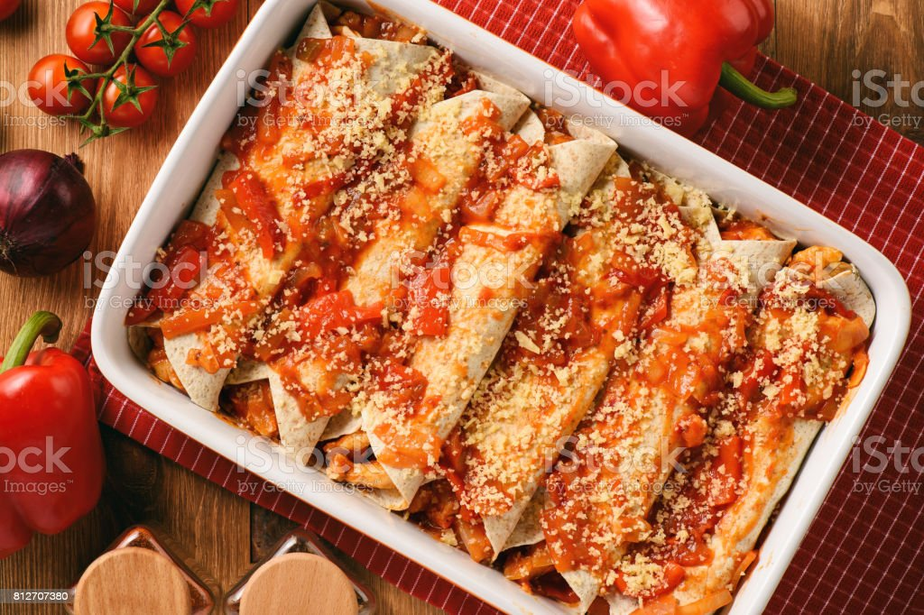 Enchiladas - mexican food, tortilla with chicken, cheese and tomatoes. stock photo