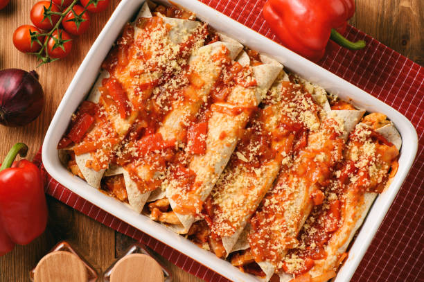 enchiladas - mexican food, tortilla with chicken, cheese and tomatoes. - casserole stock photos and pictures