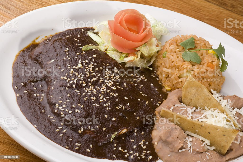 Enchiladas served with rice and beans stock photo