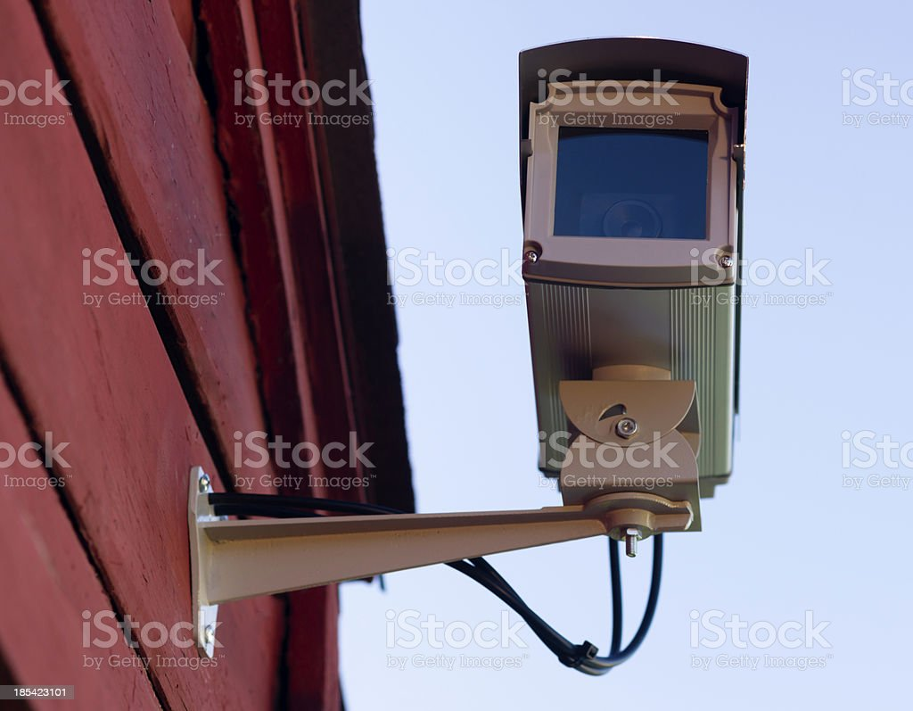 Enclosed Professional Security System Video Camera Mounted Outside royalty-free stock photo