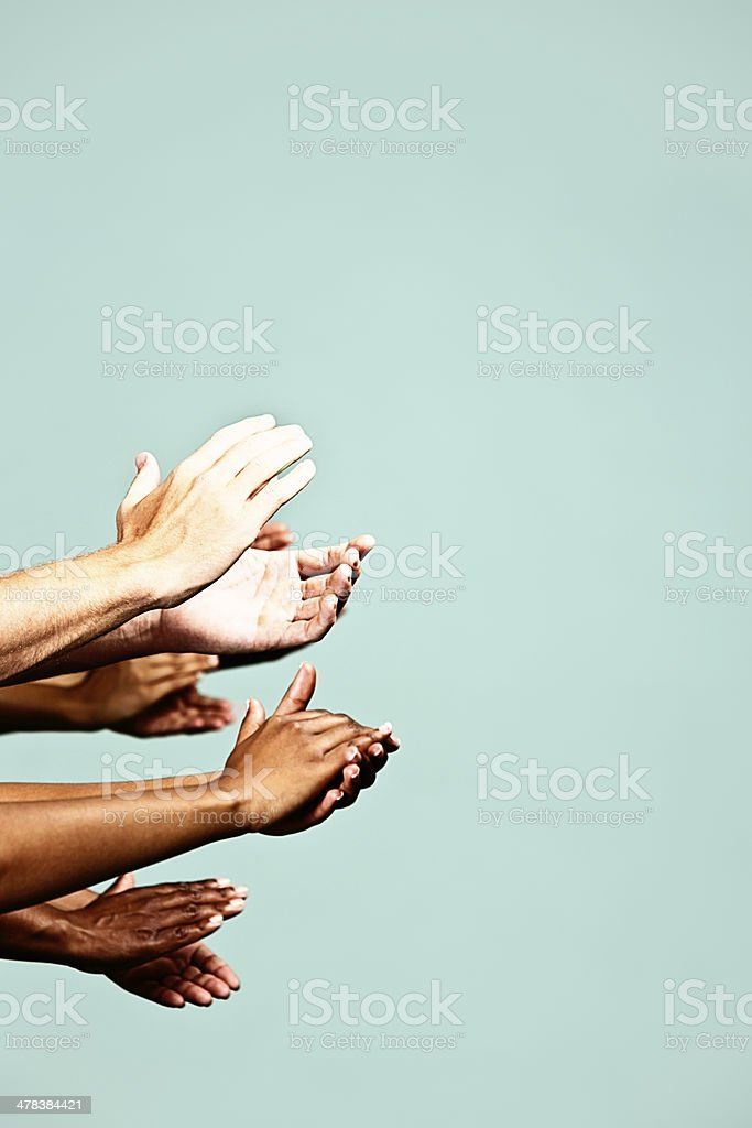 Encore! Stack of hands clapping in appreciation stock photo