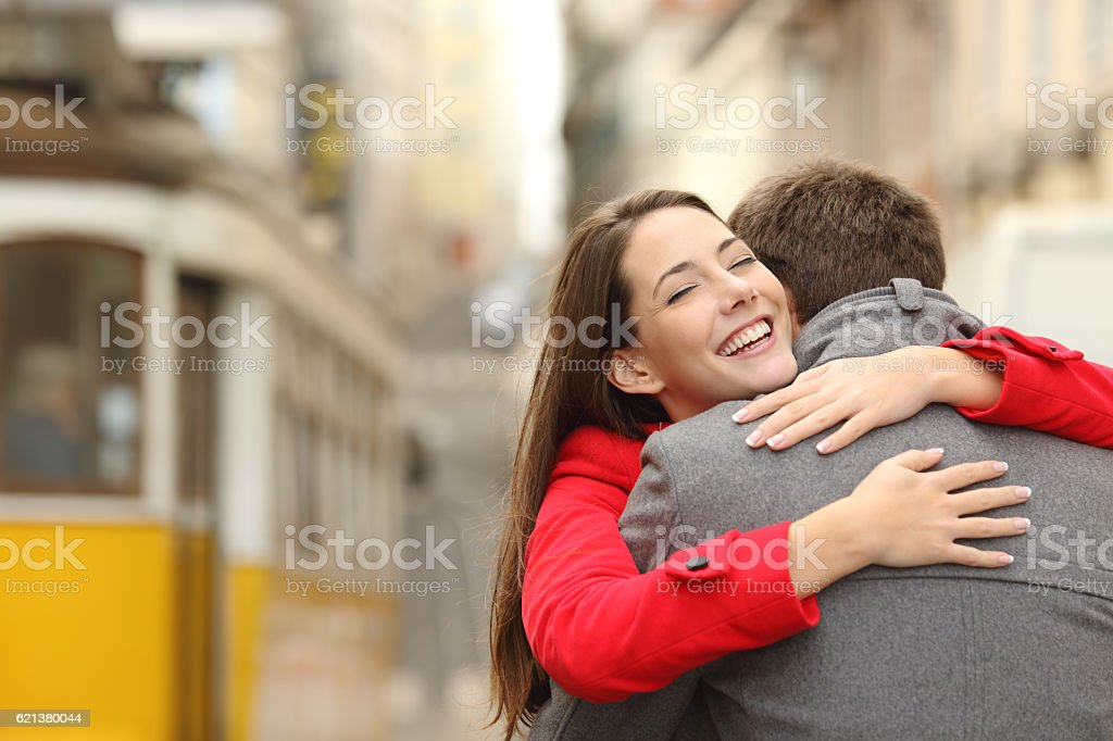 Encounter of a couple hugging in love stock photo