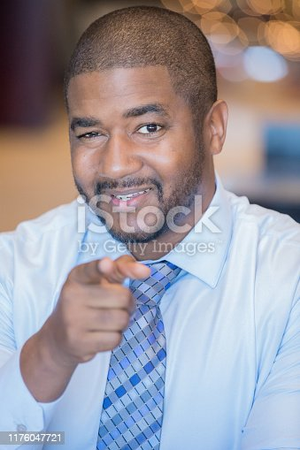 538177146 istock photo Encouraging mature man smiling and pointing 1176047721