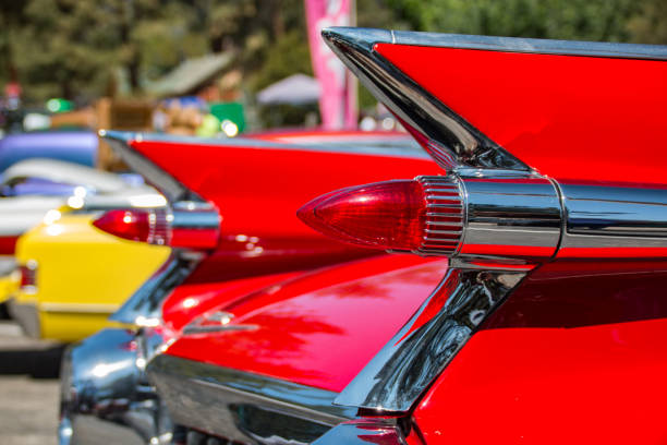 Red Fin The classic styling of a 1959 Cadillac, with tail fins and bullet taillights. car show stock pictures, royalty-free photos & images